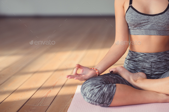 Young girl in lotus pose - Stock Photo - Images