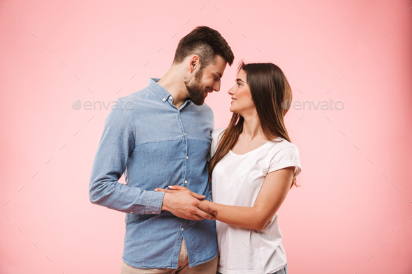Portrait of a loving young couple hugging - Stock Photo - Images