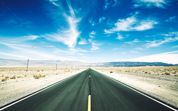 Retro toned picture of a desert road, USA. - Stock Photo - Images
