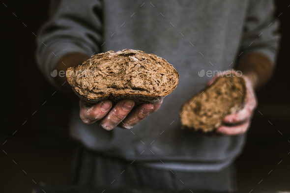 Breaking Bread - Stock Photo - Images