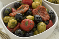 Bowl with green and black olives, peppers and tomatoes - PhotoDune Item for Sale