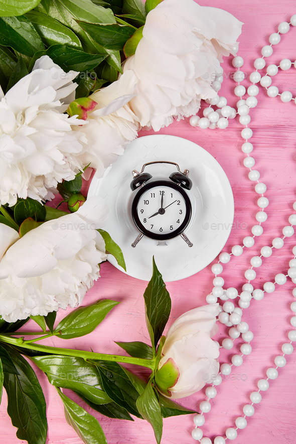 Good morning.  Tea, alarm clock and peony - Stock Photo - Images
