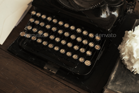 Old black typewriter with paper worth on the table - Stock Photo - Images