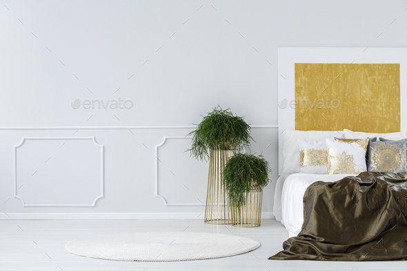 Abstract painting in minimalist bedroom - Stock Photo - Images