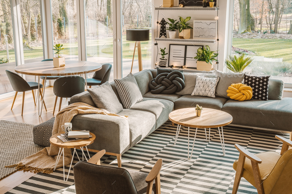 High angle view of a stylish, nordic living room interior with a - Stock Photo - Images