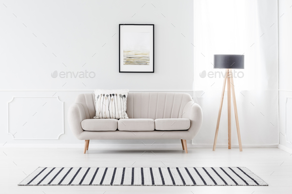 Couch against wall with molding - Stock Photo - Images