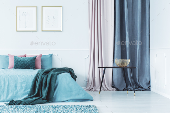 Two posters above bed - Stock Photo - Images