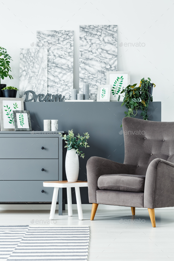 Paintings and comfortable armchair - Stock Photo - Images