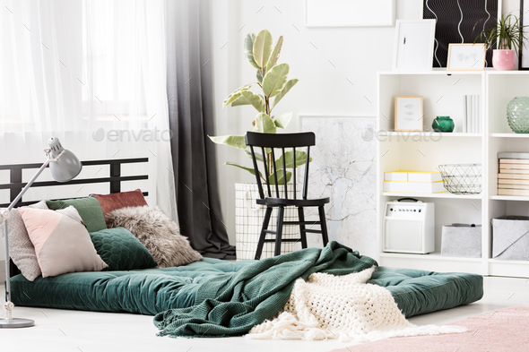 Green mattress in bedroom interior - Stock Photo - Images