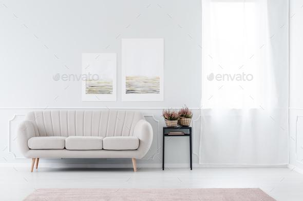Beige sofa near window - Stock Photo - Images