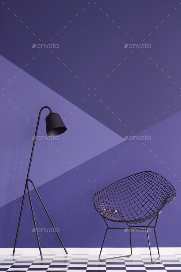 Asymmetrical violet wall in modern living room interior with met - Stock Photo - Images
