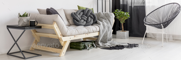 Knot cushion on couch - Stock Photo - Images