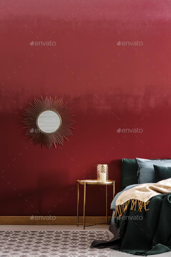 Decorative mirror on burgundy wall - Stock Photo - Images