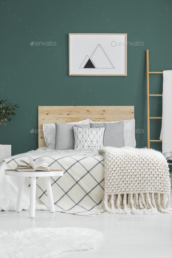 Poster above bed - Stock Photo - Images