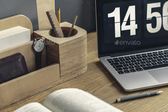 Close-up of wooden desk organizer with pencil and watch, compute - Stock Photo - Images
