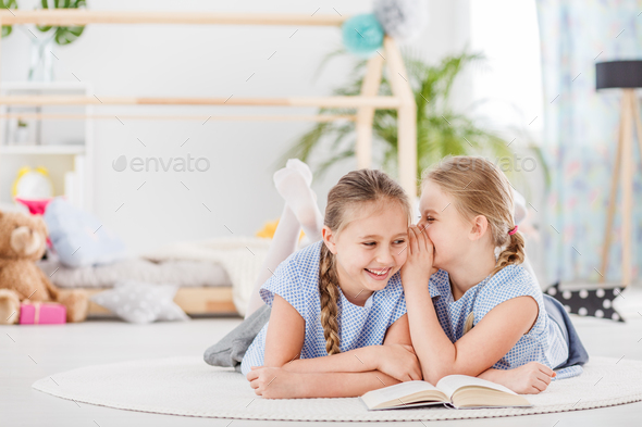Two girls talking and laughing - Stock Photo - Images