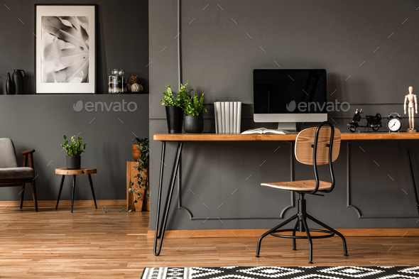 Real photo of an open space interior with black walls and moldin - Stock Photo - Images