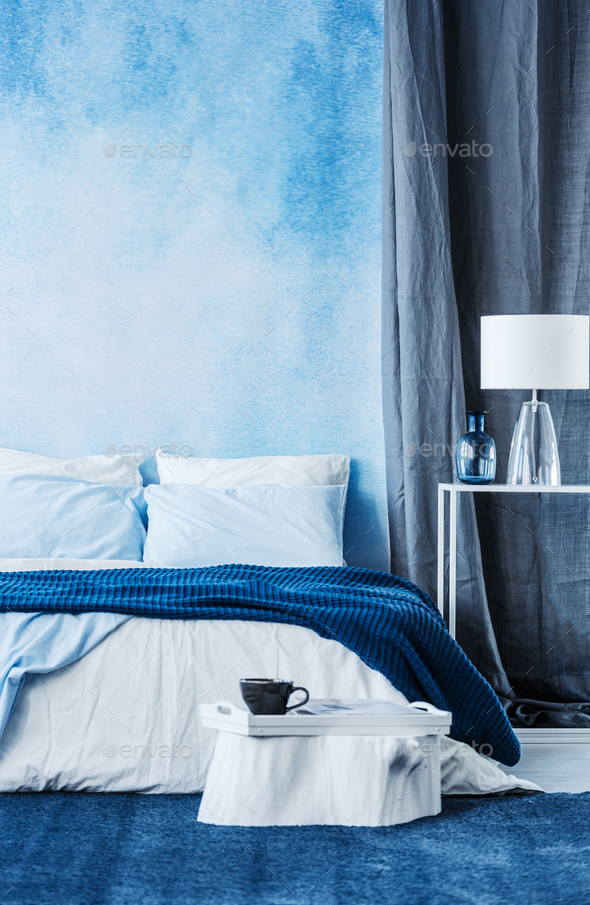 Blue watercolor paint on the wall in modern bedroom interior wit - Stock Photo - Images