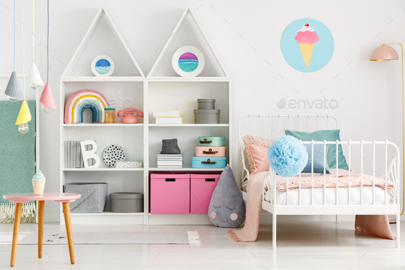 White kid's room interior with a single bed, rainbow on the shel - Stock Photo - Images