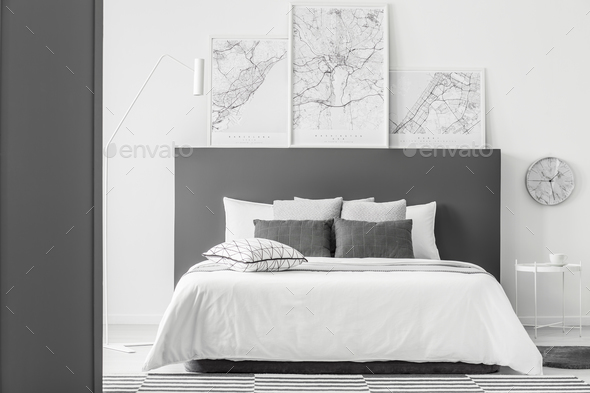 Maps in simple bedroom interior - Stock Photo - Images