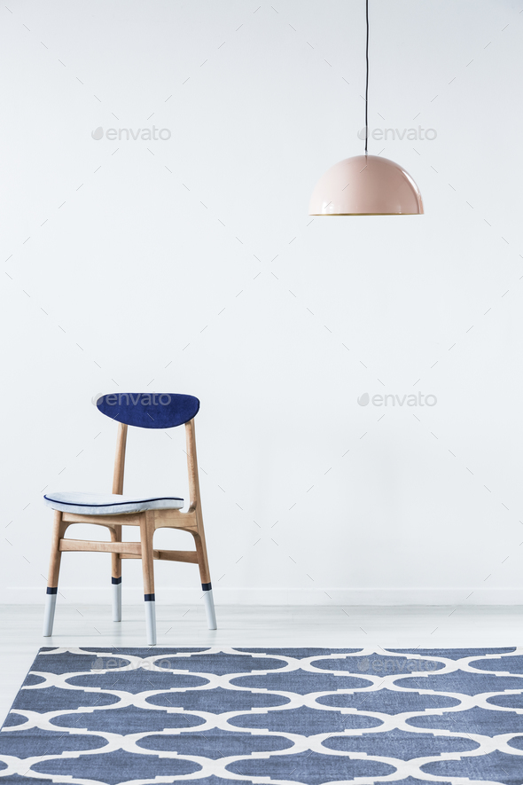 Paint-dipped chair in white interior - Stock Photo - Images
