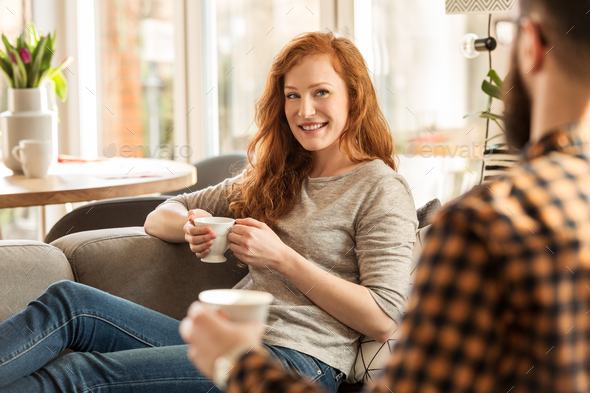 Smiling woman drinking tea - Stock Photo - Images