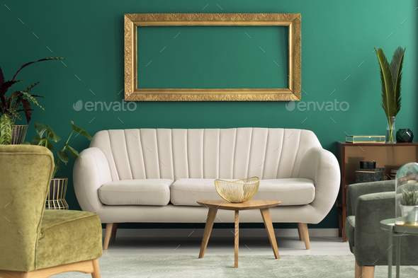Bright sofa in green interior - Stock Photo - Images