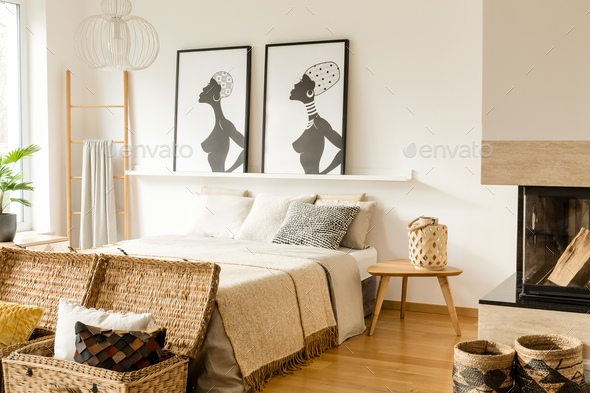 Warm bedroom interior with posters - Stock Photo - Images