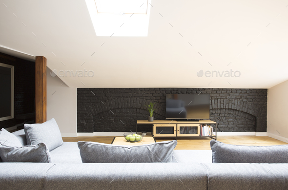 Television on brick wall - Stock Photo - Images