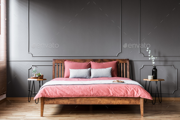 Rustic pink and grey bedroom - Stock Photo - Images