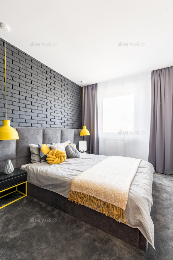 Gray and yellow bedroom interior - Stock Photo - Images