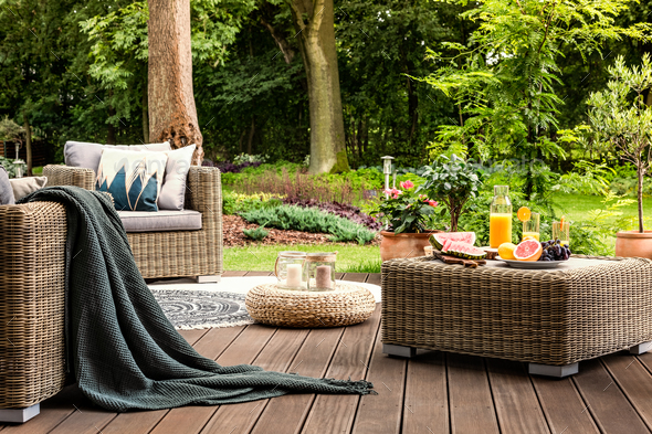 Rattan table with fruit - Stock Photo - Images