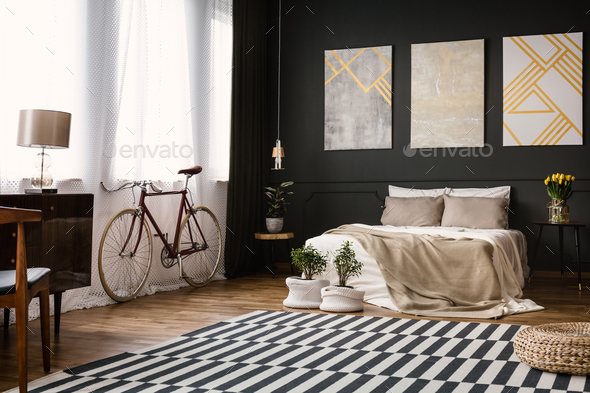 Modern bedroom with black wall - Stock Photo - Images