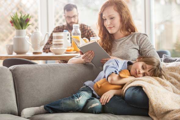 Son lying on mother's lap - Stock Photo - Images