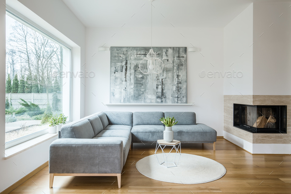 Painting in grey apartment interior - Stock Photo - Images