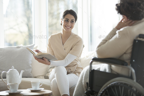 Caregiver reading book - Stock Photo - Images