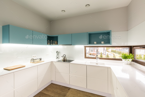 Modern white and turquoise kitchen - Stock Photo - Images
