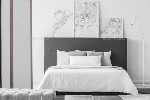 Elegant bedroom interior with maps - Stock Photo - Images
