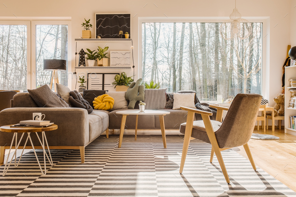 Low angle view of a scandinavian, sunlit living room interior wi - Stock Photo - Images