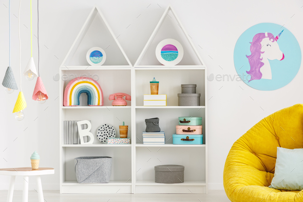 Rainbow, telephone and boxes on white shelves, unicorn poster, l - Stock Photo - Images