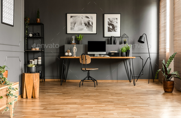 Real photo of spacious start-up office interior with a single ch - Stock Photo - Images