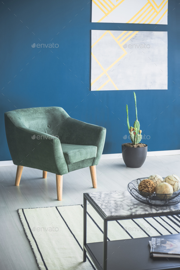Green armchair in apartment interior - Stock Photo - Images