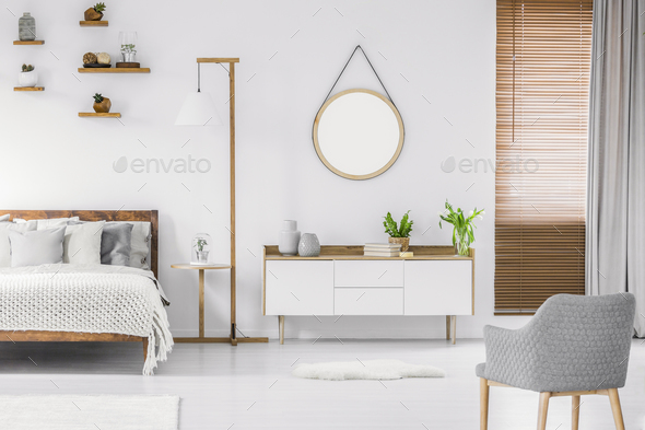 Scandinavian style white room interior with round mirror on the - Stock Photo - Images