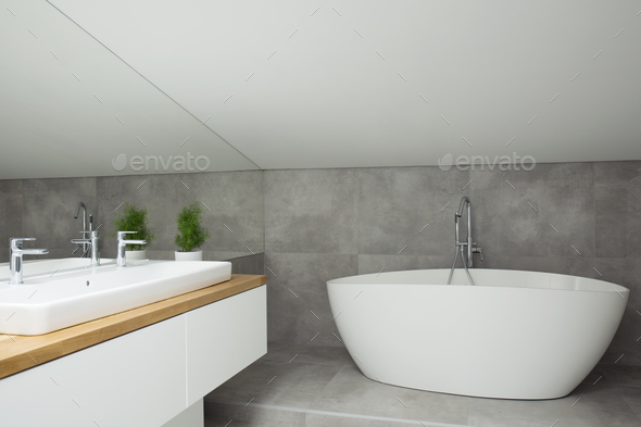 Grey bathroom interior with bathtub - Stock Photo - Images