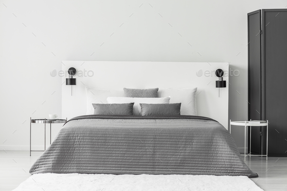 Grey and white bedroom interior - Stock Photo - Images