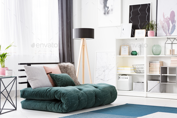 Green futon in modern bedroom - Stock Photo - Images