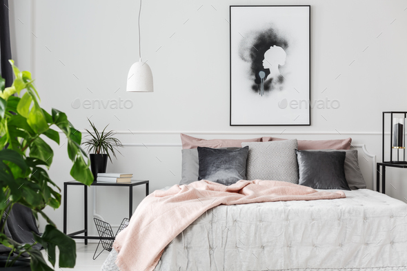 Pink blanket in feminine bedroom - Stock Photo - Images