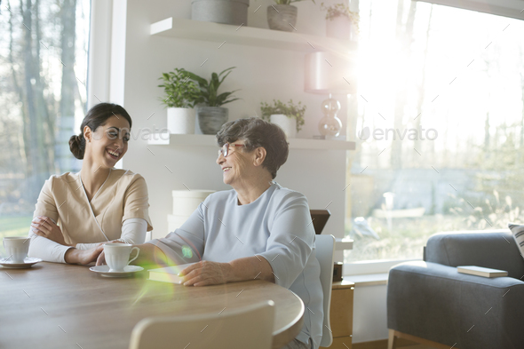 Mother and daughter laughing - Stock Photo - Images