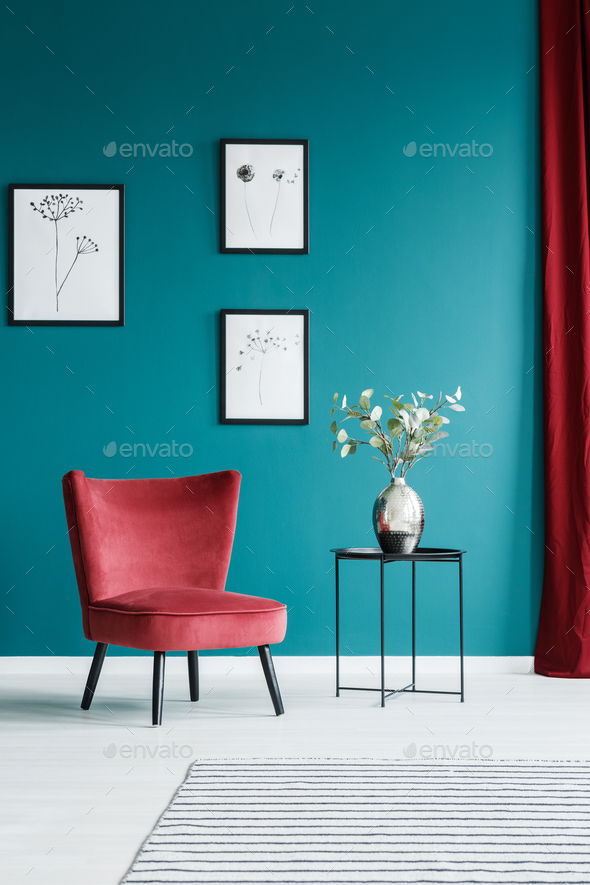 Paintings, armchair and table - Stock Photo - Images