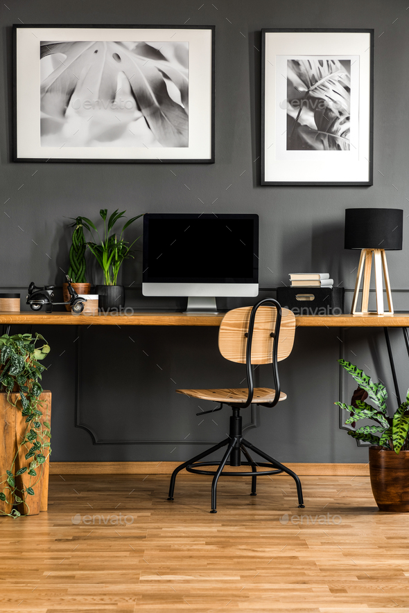 Real photo of a dark, wooden home office interior with empty com - Stock Photo - Images